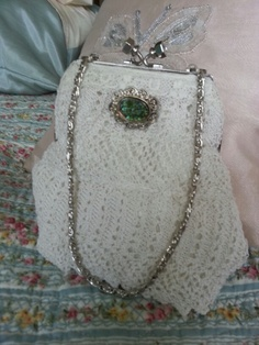 A reused frame and vintage lace embellished with an old broach by Sew Good Bags