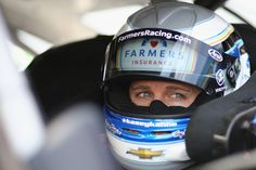 Kasey Kahne Photos - Kasey Kahne, driver of the #5 Farmers Insurance Chevrolet, sits in his car during qualifying for the NASCAR Sprint Cup Series FireKeepers Casino 400 at Michigan International Speedway on June 10, 2016 in Brooklyn, Michigan. - Michigan International Speedway - Day 1