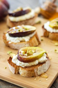 Toasted baguette slices topped with ricotta cheese, caramelized fresh figs, pistachios, and a drizzle of honey. A simple and delicious summertime crostini!