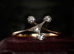 1900s Art Nouveau Asymmetrical Four European Cut Diamond Ring18K Yellow Gold and Platinum (sold) Diamonds like celestial bodies.