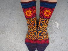 The glory of charming socks! I've never delved into sock territory (though I have the small knitting needles) & I want to get to this fun, eclectic design soon by Alice Starmore Fair Isle Knitting, Knitting Socks, Hand Knitting, Knitting Patterns, Knit Socks, Knitting Ideas, Knitting Needles, Knitting Projects, Wrist Warmers