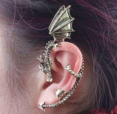 Cool Bronze Dragon Ear Cuff by NoticeApparel on Etsy, $4.99 I'm just saying that if I ever get to do a Merlin outfit I'm going to get this dragon cuff!
