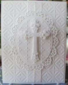 Layers of white...lacey die cuts and a cross...