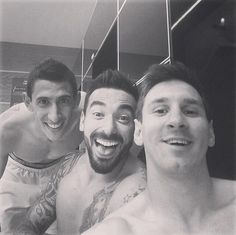 Let me take a selfie: Messi celebrates with Angel Di Maria and Ezequiel Lavezzi in the dressing room