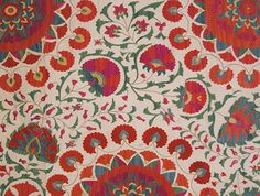 Graceful floral motifs dominate in Uzbek suzanis--both in nineteenth century pieces and in modern work.