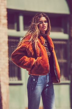 Furry Bomber   Ultra luxe bomber jacket featuring a statement faux fur design.    * Zipper closure   * Hidden side pockets   * Lined   * Contrast ribbed back band