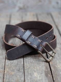 """Our handmade belts are available in different widths. Narrow is 1 1/2"""" thick with a single tongue buckle. Wide is 1 3/4"""" thick with a double tongue buckle. Buckles are antiqued brass. The perfect way to compliment your wardrobe. Comes in Nero or TMoro."""