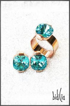 Sky Glam Swarovski Crystal Stud Earrings and Statement Ring THESE ON TREND STYLISH STUD EARRINGS IN LIGHT TURQUOISE AND ROSE GOLD ARE A UNIQUE COMBINATION OF CHARM AND CHUTZPAH. BOLD, SIMPLE, ELEGANT STUD EARRINGS. Jewellery that make you feel like a diva and shine bright. This are definitely cocktail hour jewellery. They'll enhance your entire outfit and make you look and feel fabulous and sparkly. Rose Gold Lights, Unique Mothers Day Gifts, Light Turquoise, Jewelry Branding, Cool Gifts, Statement Rings, Swarovski Crystals, Diva, Cocktail