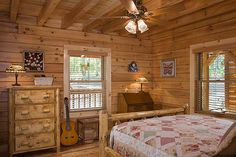 Photos & floor plan of a custom lakeside log home designed & milled by Honest Abe Log Homes; family owned/operated since nationwide sales & delivery. Log Home Bedroom, Bedroom Ideas, Log Home Interiors, Log Cabin Homes, Log Cabins, Log Home Designs, Prefab Cabins, Log Home Plans, Guest Bedrooms
