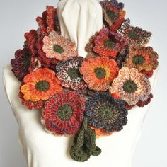 Thanks for looking.  This scarf has 51 pcs of 3.25/8cm hand crochet flowers. The length from end to end is about 59/150cm. I chose red/brown/orange shade of colors for this scarf, colors and length can be made to order. The scarf is made with 66% wool and 34% acrylic blend multicolor yarn and dark green blend yarn .