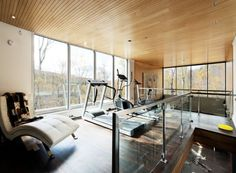 Beautiful wooden ceiling and the fabulous view outside add to the appeal of this home gym - Decoist