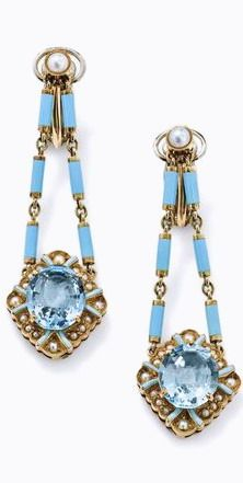 An aquamarine and pearl ear pendant suite The oval mixed-cut aquamarine, claw-set within a scalloped half-pearl and light blue enamel frame to a similarly set surmount and suspended from a similar blue enamel baton-link chain, earclip pendants of similar design, length 5.8 cm.