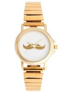 Mustaschklocka / Armbandsur - Mustasch Guld    Snygg mustaschklocka som väcker uppmärksamhet.  Klockan har ett armband som är elastiskt och passar de flesta.    Storlek  Bredd: 4cm