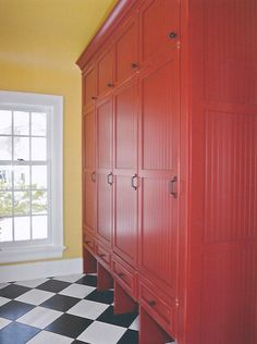 Red entry lockers with doors, bottom has small drawers plus open cubbies for shoes