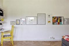 A straight line gallery wall.