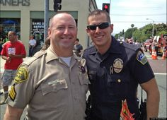 Los Angeles County Sheriff's Sergeant Don Mueller and LAX Airport Police Officer David Ayala celebrate pride as they prepare to march with over 60 other openly gay officers in the 2012 West Hollywood CSW Pride Parade.