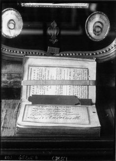 The prayer book with the inscription Marie Antoinette wrote in it shortly before her execution, along with locks of hair from Madame Elisabeth and Marie Therese Charlotte, from an exhibit at Versailles in the 1920s.