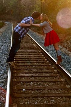 Very Cute for a wedding photo. Especially since Bill works for the railroad.