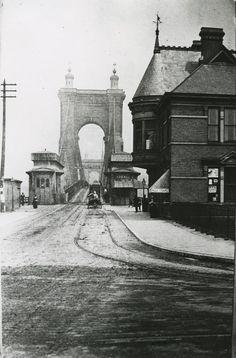 "Suspension Bridge from Covington to Cincinnati, circa 1890. The sign at the bridge entrance reads ""TROTTING POSITIVELY FORBIDDEN."""