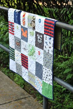 Make a Onesie Quilt - cute way to save all those baby clothes in a quilt - full tutorial