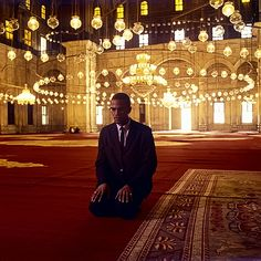 Malcolm X prays at a mosque in Egypt ~ Photo by...?