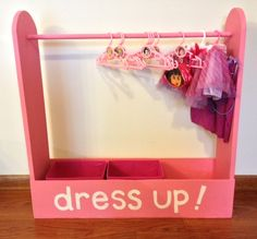 "Dress-up Station - (5)-1""x8""x4' wood lumber and a wooden dowel rod add a couple of childrens hangers and baskets for loose items,"