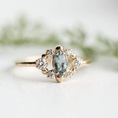 So in love with the mossy sapphire in this custom marquise cluster ring