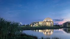 A trio of dome-shaped structures enclose the Taoyuan Sewage Treatment Project in northern Taiwan, designed by Habitech Architects to resemble mountains, complete with a waterfall and fish pond. Sewage Treatment, Amazing Architecture, Ecology, Taiwan, Pond, Taj Mahal, Waterfall, Architects, Exterior