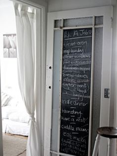 Love this old vintage door with the chalkboard paint middle. Great way to leave love notes or a honey do list. :)