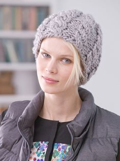 Knitted chunky hat with cabeling in Lion Brand Hometown USA! Download the FREE pattern and find all the supplies at LoveKnitting!