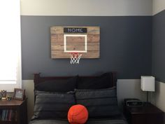 Let us make this mini basketball hoop for your son or daughter. Made of reclaimed wood, this hoop is 30 wide and 22 high and includes the hoop. You