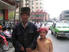 Uyghur father and child in Kashgar, Xinjiang