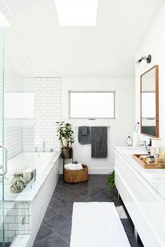 White subway tile with dark gray grout, dark floor tile... Change out cabinets to light gray ones