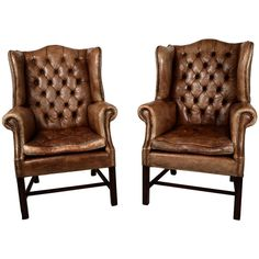 Vintage Pair of Leather Wingbacks | From a unique collection of antique and modern wingback chairs at http://www.1stdibs.com/furniture/seating/wingback-chairs/