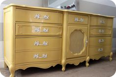 French provincial dresser painted mustard yellow.