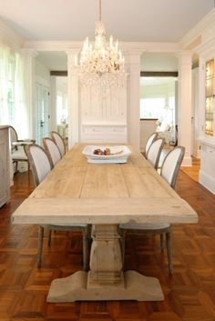 farm table + elegant chandelier and chairs