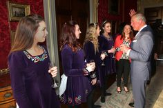 Prince Charles, Prince of Wales raises his hand as he discusses Irish dancing techniques with the Tir na N-Og Irish Dancers left-right) Sarah White, Rose McAuley, Zoe McGarry, Naomi Brown and their teacher Bronagh Craig at a Music & Words for a Spring Evening at Hillsborough Castle during a visit to Northern Ireland on May 9, 2017 in Hillsborough, County Down, Northern Ireland. - Day One