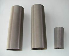 Three cylindrical filter tubes made of multi layers woven mesh cloth.