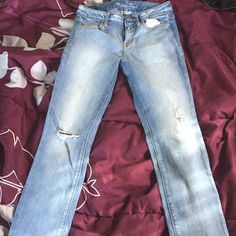 American Eagle-high waisted jeggins. SIZE 8 Only worn twice. Distressed, light denim very soft jeans. Well taken care of, coming from a smoke free home. American Eagle Outfitters Jeans Skinny