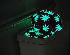 Glow in the dark pot leaf baseball cap.