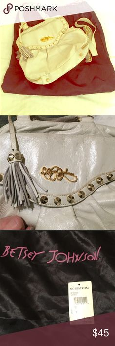 Betsy Johnson white studded purse White handbag with gold studs and zipper detail also has tassels. I loooovvvee this purse so there is some normal wear and tear shown in pics (any questions please ask) comes with original dustbag and strap to make it a shoulder bag. Has been in dustbag ans not used for the last year time to find it a good home 💕 Betsey Johnson Bags
