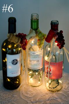 Handcrafted Recycled Lighted Wine Bottles-we have a crafter at our local winter farmers market who sells these...great gift idea!