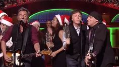 "Watch Bruce Springsteen, Paul McCartney and the 'SNL' cast sing ""Santa Claus is Coming to Town,"""