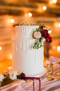 White drip wedding cake with love topper
