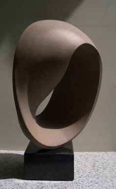 Mobius, 2004, indiana limestone. Michael Binkley abstract stone sculpture.: