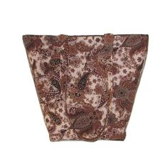 Brown Paisley Tote Bag, Floral Cloth Purse has Dark Brown  Black Paisley  Flowers on a Brown Background.   This Handmade Handbag is fully lined in Dark Brown, has 5 slip type Brown pockets, 2 Handles that match the outside fabric  a Magnetic Snap Closure.   I use thick fleece interfacing, sandwiched between the lining  outer fabrics to add stability  durability to this fabric tote bag.   This is the perfect size for an everyday purse, book bag, tote bag, craft bag, dance bag, shoulder bag…