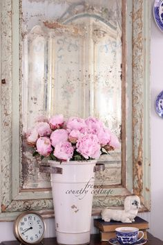 French country. Love the pink with the creamy whites.
