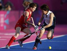 Women's Hockey - Britain's Helen Richardson challenges Japan's Chie Akutsu