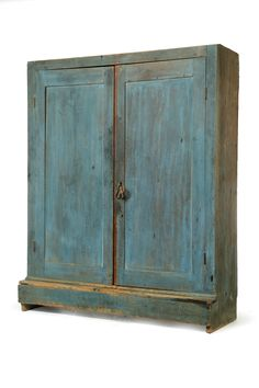 "AMERICAN PAINTED CUPBOARD. Nineteenth century, poplar. One-piece cupboard with paneled doors and interior shelves. Old blue paint. 76.5""h. 61.5""w. 22.5""d."