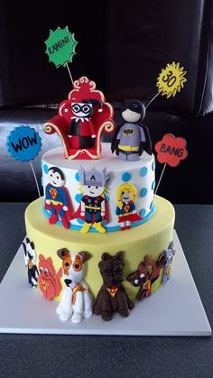Comic Con cake.  All members of one family as superheroes - even their animals!! Cake by Homemade By Hollie.